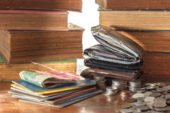 Old  leather wallets and bank books with coins  on wooden grunge Royalty Free Stock Images