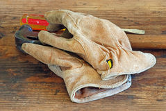 Old Leather Work Gloves and Tools Royalty Free Stock Photo
