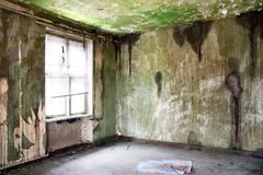 Old leave deserted room. Grunge and dirtiness wall Stock Image