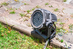 Old LED Spotlight on Concrete Brick Ground, Outdoor.  Royalty Free Stock Images