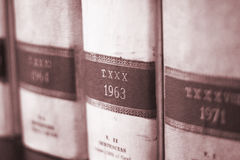 Old legal lawyers books. Old legal books law reports on shelves of law offices of attorneys and lawyers in judicial reference library Stock Image