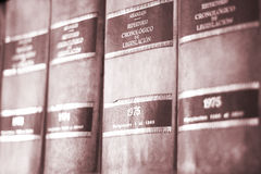Old legal lawyers books. Old legal books law reports on shelves of law offices of attorneys and lawyers in judicial reference library Royalty Free Stock Image