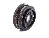 Old lens. Objective from classic manual film camera isolated on white royalty free stock image