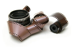 Old lens with film strip Royalty Free Stock Photography