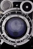 The old lens vintage camera looks at you, closeup Royalty Free Stock Photos