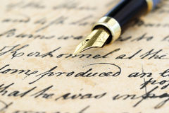 Old letter. Close up of fountain pen on old letter Stock Image