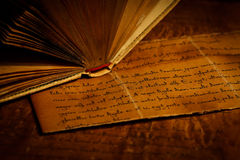 Old letter and book spine, detail Stock Photography