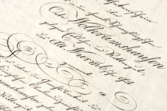 Old letter with calligraphic handwritten text Stock Photos