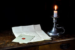 Old letter and candle Royalty Free Stock Image