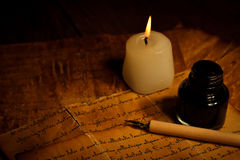 Old letter with candle and pen Stock Images