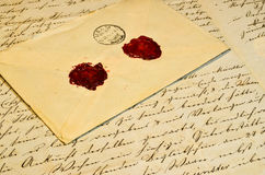Old letter and envelope. Old vintage letter and envelope with wax seals Royalty Free Stock Image