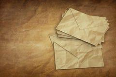 Old Letter envelopes for mail postage on old Paper.  Stock Images