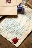 Old letter sealed with red sealant and written in blue ink Royalty Free Stock Images
