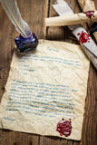 Old letter written bird pen and sealed sealant. On old wooden table stock photography