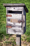 Old letterbox. Beautiful old letterbox at a meadow Stock Image