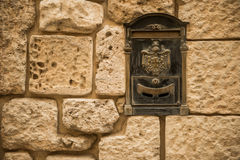 Old letterbox in the city of Valletta Stock Image