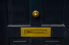 Old letterbox in the door, traditional way of delivering letters Royalty Free Stock Images