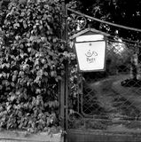 Old Letterbox. On a fence, captured on black & white film with a retro Rolleiflex camera Stock Photo