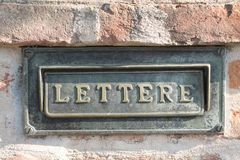 Old letterbox at a historic facade. Old grunge letterbox at a historic facade. Communication object background Stock Image