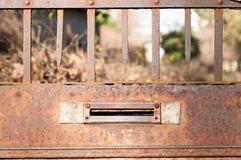 Old letterbox or mailbox in the gate door traditional way of delivering letters or mail to the house address close up.  Royalty Free Stock Photos
