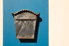 Old letterbox on the wall. An old irish letterbox on the blue part of the wall with light copyspace Stock Photos