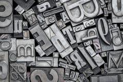 Old letterpress metal type printing blocks. Background of random vintage letterpress metal type printing blocks, black and white image stock image