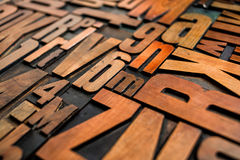 Old letterpress wood type printing blocks. Antique letterpress wood type printing blocks Royalty Free Stock Photos