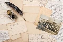Old letters, antique feather pen and vintage photo of children Royalty Free Stock Photo