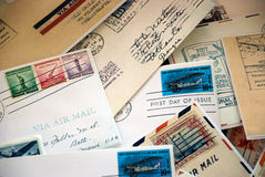 Old Letters Background. A collection of letters with canceled united states air mail stamps.  This would make a nice background. It could illustrate postage Royalty Free Stock Image