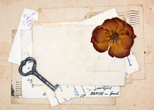 Old letters, empty post cards and dried rose Stock Photos