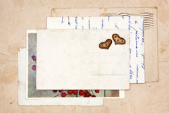 Old letters, empty post cards and two hearts. Vintage background Royalty Free Stock Image