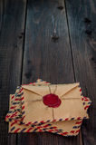 Old letters envelopes with a wax stamp on wooden table royalty free stock photography
