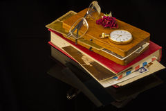 Old letters, glasses, dried rose, pocket watch all on a black background with blank space Royalty Free Stock Image