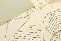 Old letters and a grungy envelope Royalty Free Stock Image