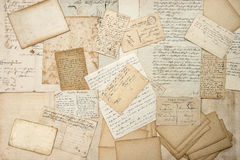 Old letters, handwritings, vintage postcards. Grungy paper textu Stock Image