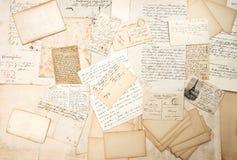 Old letters, handwritings and vintage postcards. Nostalgic sentimental background. ephemera Royalty Free Stock Images