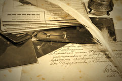 Old letters, inkpot, feather and photos Royalty Free Stock Images