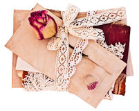 Old letters and notebook tied with lace ribbon. Royalty Free Stock Photo