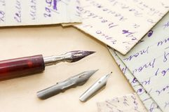 Old letters and pen Royalty Free Stock Photo