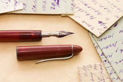 Old letters and pen as a background Royalty Free Stock Image