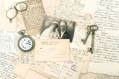 Old letters and postcards, antique accessories and photo Stock Image