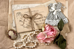 Old letters, postcards, dry rose flower and vintage things Royalty Free Stock Image