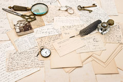 Old letters and postcards and photo of a family Stock Images