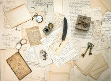 Old letters and postcards, vintage accessory and antique photo. Of a child. retro style nostalgic background. top view Royalty Free Stock Image