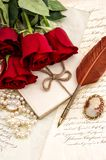 Old letters red rose flowers feather pen Valentined Day Love. Old letters, red rose flowers and antique feather pen. Valentined Day Love concept stock images