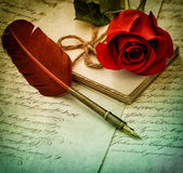 Old letters, rose flower and antique feather pen.  Vintage style Stock Photos
