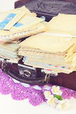 Old letters in suitcase. Pile of old personal letters in retro suitcase royalty free stock images