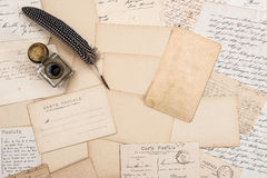Old letters, vintage postcards and antique feather pen. Mock up Stock Photography