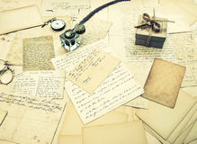 Old letters, vintage postcards and antique feather pen Stock Photos