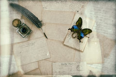 Old letters, vintage postcards and antique pen Stock Photos